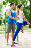 Couple exercising at outdoor gym Stock Images