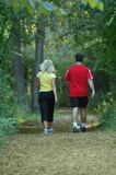 Couple exercising at the park. Couple walking at the park Royalty Free Stock Photo