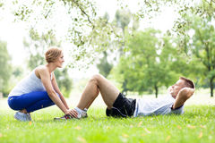 Couple Exercising In Park Stock Images