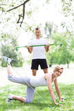 Couple Exercising In Park Stock Photography