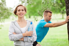 Couple Exercising In Park Royalty Free Stock Photography