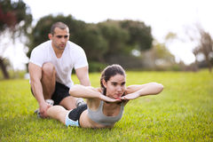 Couple exercising at the park Royalty Free Stock Images