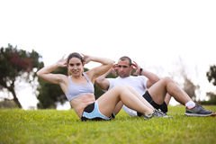 Couple exercising at the park Royalty Free Stock Image