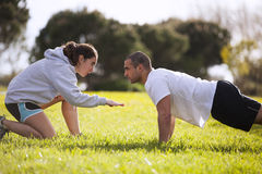 Couple exercising at the park Stock Photo