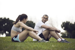 Couple exercising at the park Royalty Free Stock Photography