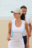 Couple exercising by the sea Royalty Free Stock Images