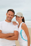 Couple exercising by the sea Royalty Free Stock Photo