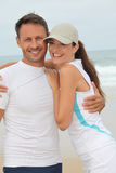 Couple exercising by the sea Royalty Free Stock Image