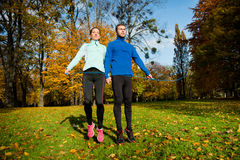 Couple exercising with skipping rope Royalty Free Stock Image