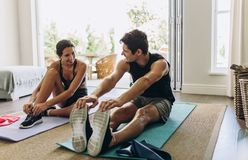 Free Couple Exercising Together At Home Stock Images - 154528594