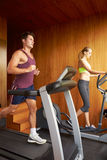 Couple Exercising Together In Home Gym Stock Photography