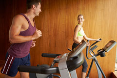 Couple Exercising Together In Home Gym Royalty Free Stock Image
