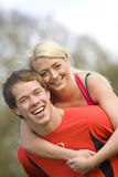 Couple exercising togther stock photos