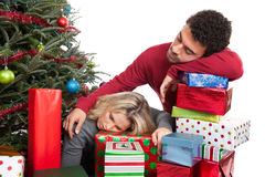 Couple exhausted from Christmas Stock Photography