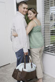 Couple Exiting House Royalty Free Stock Image