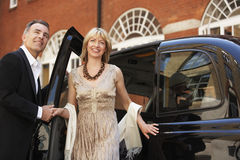 Couple Exiting London Taxi Royalty Free Stock Photography