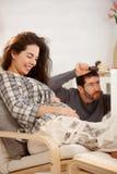 Couple expecting baby fixing crib royalty free stock image