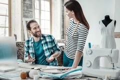 Couple of experienced talented designers working together stock images