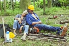 Couple of expert woodsmen taking a break Royalty Free Stock Images