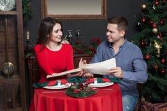 Couple explore the menu at luxury restaurant Stock Photo
