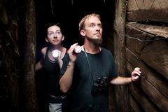 Couple exploring abandoned gold mine in Costa Rica. Couple exploring rustic abandoned gold mine in Costa Rica stock images