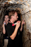 Couple exploring abandoned gold mine in Costa Rica Stock Photography