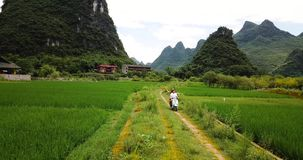 Couple exploring Yangshuo villages on the motorbike stock footage