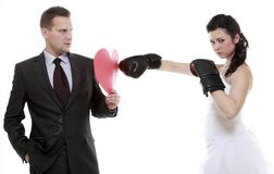 Couple expressive fighting. Angry wife boxing husband. Stock Photos