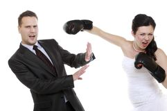 Couple expressive fighting. Angry wife boxing husband. Stock Image