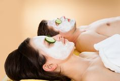 Couple with face mask relaxing in spa Stock Image
