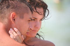 Couple faces on beach stock images