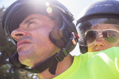Couple faces in helmets. Couple wearing motorcycle helmets making self portrait Royalty Free Stock Photo