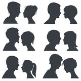 Couple faces, young boy and girl head vector silhouettes isolated on white Royalty Free Stock Photography