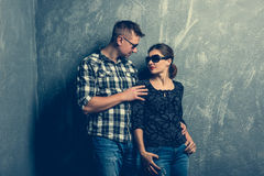 Couple facing each other on grey background Royalty Free Stock Photos