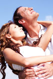Couple facing sky together looking at the sun Royalty Free Stock Photo