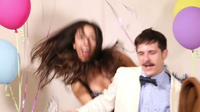Couple fainting from too much dancing in party photo booth stock video