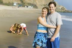 Couple with Family Enjoying Beach Stock Photos