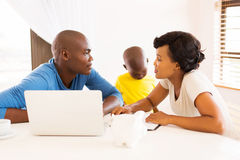 Couple family finances. Young african couple doing family finances at home Royalty Free Stock Image