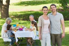 Couple with family having lunch in the lawn Stock Photography