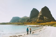 Free Couple Family With Baby Traveling Together Walk On Beach In Norway Royalty Free Stock Image - 164739166