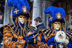 Couple with fantasy Carnival Маsk and a dog at Carnival of Venice Stock Photos