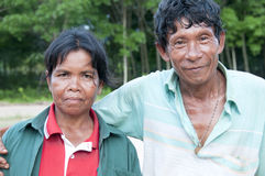 Couple Farmer. A couple farmer standing in front of a rubber farm Stock Images