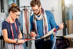 Couple of fashion designers working at the studio royalty free stock photo