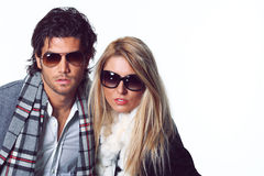 Couple of fashion models with sunglasses Stock Images