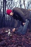 Human skeleton found in winter forest by couple of man stock image