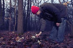Human skeleton found in winter forest by couple of man stock photos
