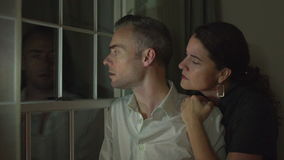 A couple is fearful of a crime outside. View as a couple is fearful of a crime outside stock video