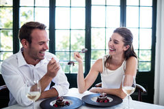 Couple feeding each other and smiling Royalty Free Stock Photo