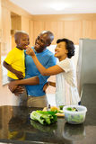 Couple feeding son vegetable Royalty Free Stock Images
