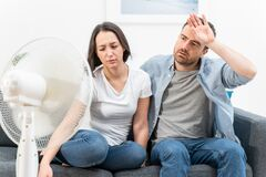 Free Couple Feeling Bad At Home After Summer Heat Royalty Free Stock Images - 178425729
